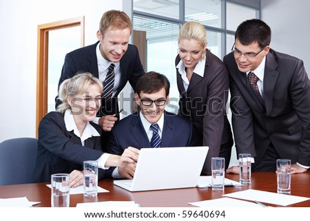 Young employees working in the office - stock photo