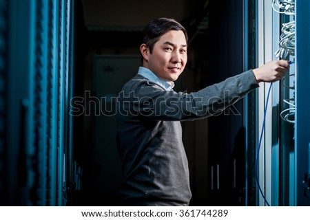 Young engineer businessman in server room