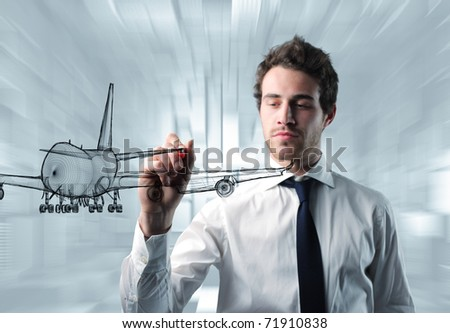 young engineer drawing 3d airplane