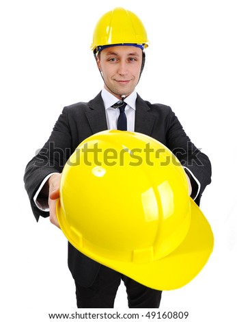 Young engineer giving you a helmet: come to work with me - stock photo