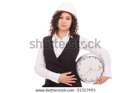 Young engineer holding a clock, isolated over white
