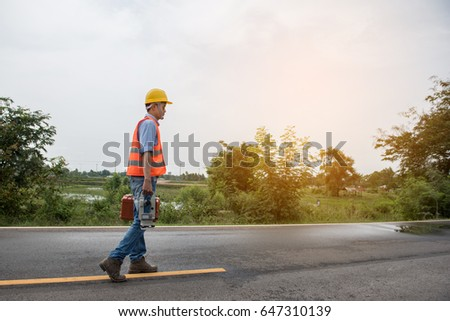 Young engineer man with Surveyor equipment tacheometer or theodolite worker on the road.