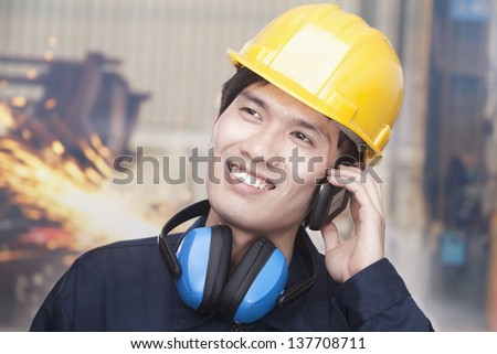 Young Engineer on the Phone - stock photo