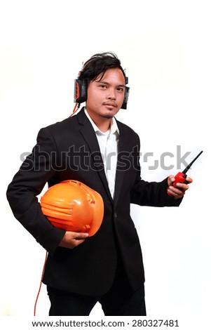 Young engineer portrait and headphones - stock photo