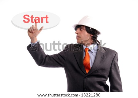Young Engineer, presses the Start button, isolated in white background