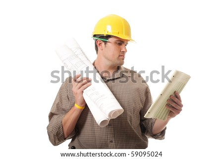 Young engineer reviewing plans at work - stock photo