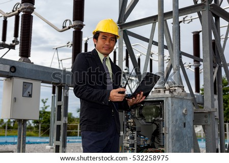 Young engineer to check the electrical ground chicken with a computer system