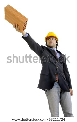 Young engineer with hat and brick isolated in white