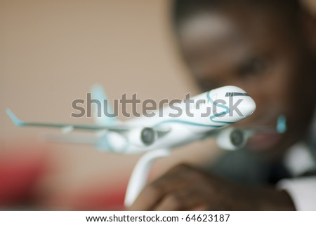 Young engineer with his airplane model