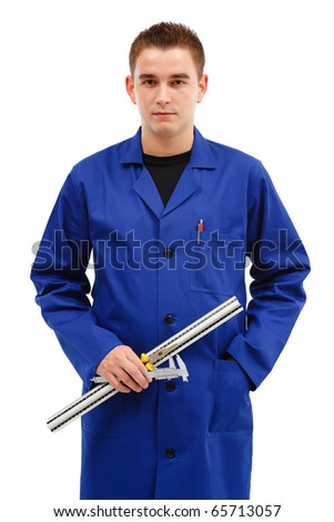 Young engineer with his tools, ruler, caliper and pliers - stock photo