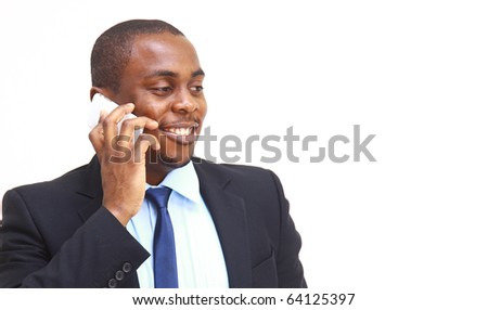 Young entrepreneur holding his coat over shoulder while talking on cell phone - stock photo