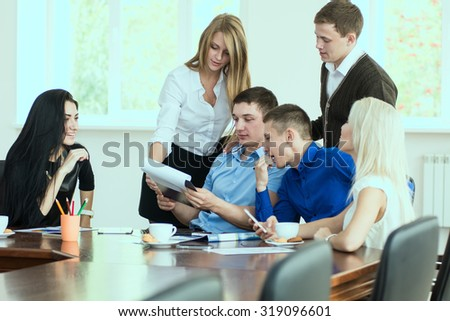 Young entrepreneurs at a business meeting in the office. business discussion - stock photo