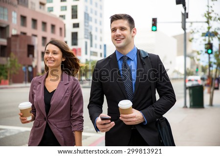 Young entrepreneurs downtown in business district walking street day - stock photo