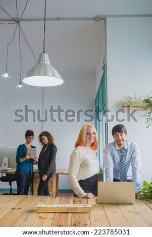 Young entrepreneurs looking at camera - stock photo