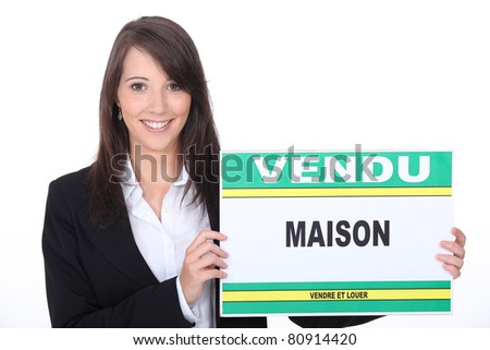 young estate agent with sold sign - stock photo