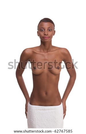 Young ethnic topless black female with slicked back hair wrapped in white bath towel around her hips after sauna - stock photo