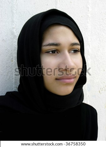 Young ethnic woman with hopeful look.