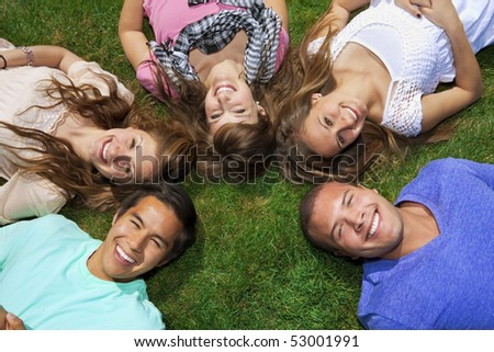 Young ethnically diverse friends in their 20s Having Fun - stock photo