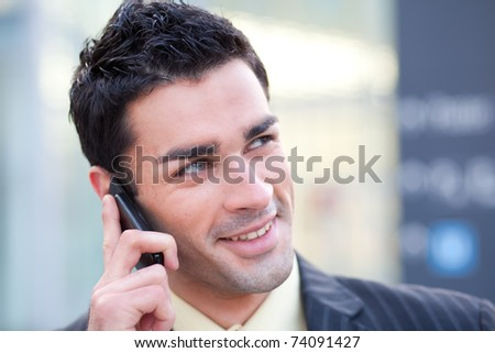 young european businessman listening to his colleague at his mobile phone