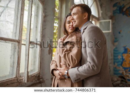 Young European couple hugging in an old building.