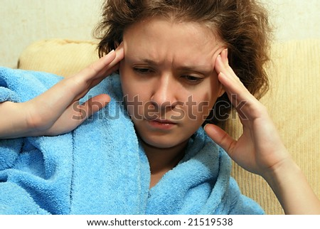 Young European woman with headache