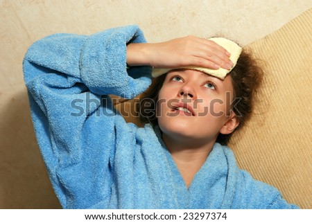 Young European woman with headache - stock photo