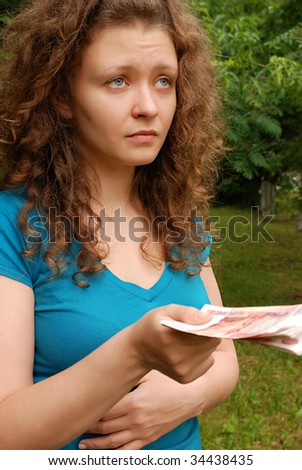 Young European woman with Russian money - roubles - stock photo