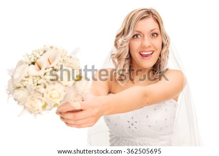 Young excited bride preparing to toss the wedding flower isolated on white background - stock photo