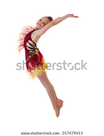 Young excited girl jumping in the studio, isolated on white - stock photo
