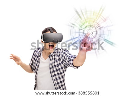 Young excited man experiencing virtual reality through VR headset isolated on white background - stock photo