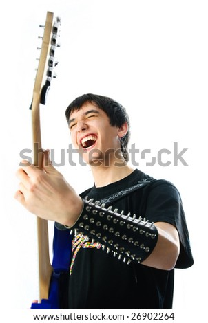 young excited man playing a guitar isolated against white background - stock photo