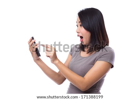 Young exciting woman with smartphone. - stock photo