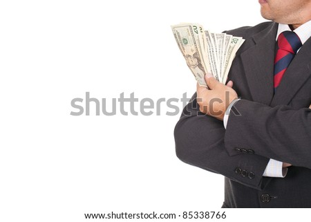 young executive businessman holding a lot of dollar bills - stock photo