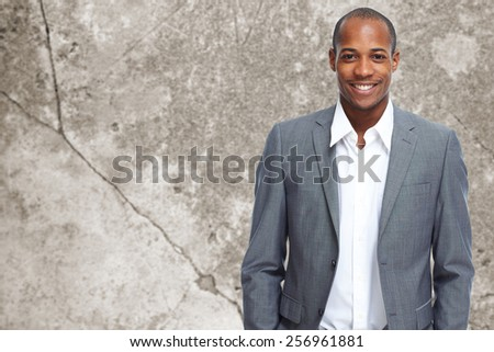 Young executive businessman over office background. - stock photo