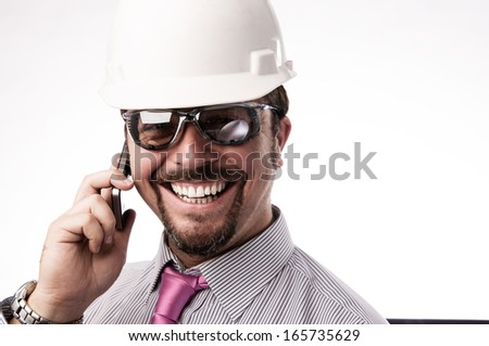 Young executive engineer on the phone - stock photo