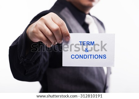 young executive holding card written term and condition - stock photo
