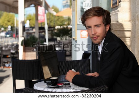Young executive in a cafe - stock photo