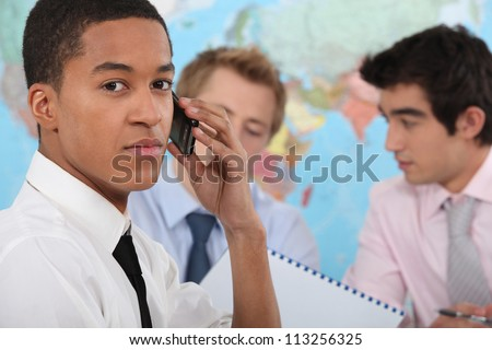 Young executive making a phone call - stock photo