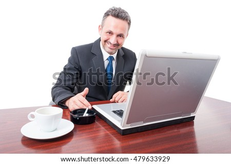 Young executive manager drinking coffee and smoking in his break isolated on white  background