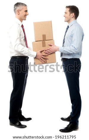 Young executive receiving a cardboard boxes - stock photo