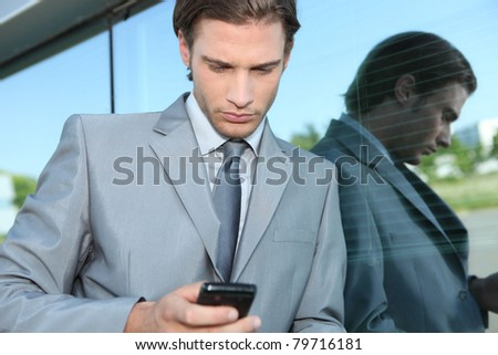 Young executive using a mobile phone - stock photo