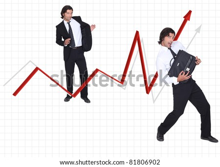 young executive with suitcase and graphic arrow - stock photo