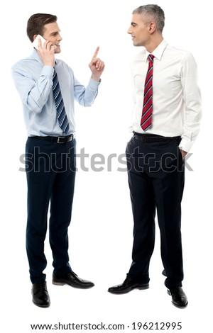 Young executives discussing business strategies - stock photo