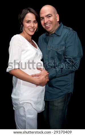Young expecting couple very happy and smiling proud. - stock photo
