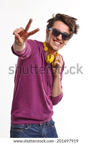 Young expressive and happy guy wearing yellow headphones.Happy deejay. - stock photo