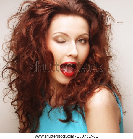 Young expressive redhair woman with red lips. Close up portrait.