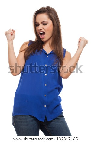 Young expressive woman feels success and scream isolated over white background