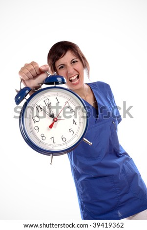 Young Expressive Woman In Blue Uniform Shirt Holding A Big Alarm Clock - stock photo