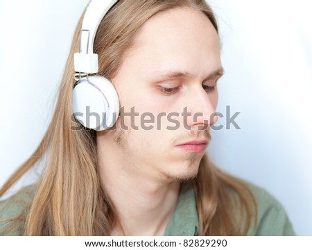 Young fair haired man with headphones