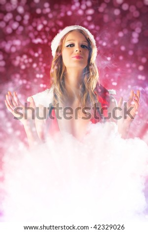 Young fairy woman in santa clothing with smoke effect. - stock photo